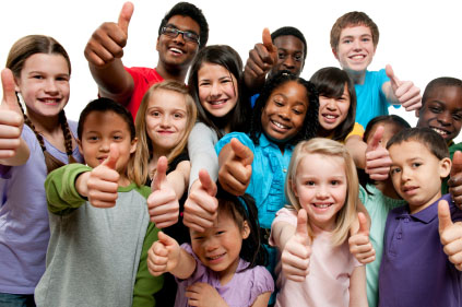 group of smiling children giving thumbs up