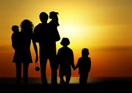 silhouette of family looking at sunset- image