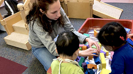 ECS student working with young children