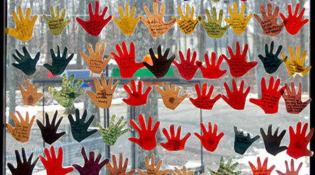 brightly colored hand cut outs decorate window