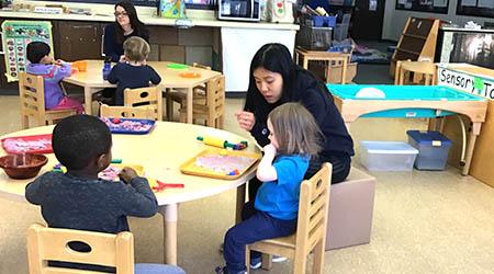 ECS teacher working with children